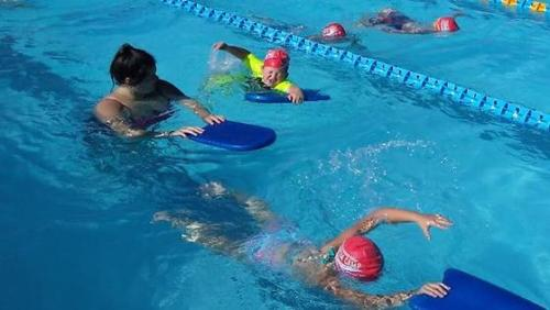Children Swimming with Boards